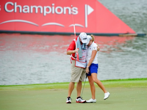 "A congratulatory hug from her ""Caddy of the Year"", Travis Wilson"
